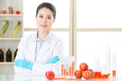 Asian female scientist looking for cure for genetic modification Royalty Free Stock Image