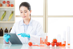 Asian female scientist touch the digital tablet to research Royalty Free Stock Photo