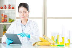 Asian female scientist touch the digital tablet to research for Royalty Free Stock Photography
