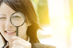 Asian female searching with magnifier Royalty Free Stock Photos