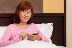 Asian female senior lifelong learning Royalty Free Stock Photography