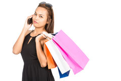 Asian Female Shopper Cell Phone Shopping Bags At Royalty Free Stock Photos