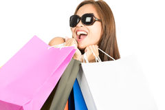 Asian Female Shopper Mouthing Bags Away Camera H Stock Photo