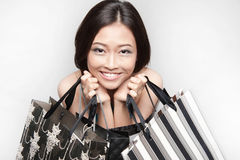 Asian female shopper with paper bags Royalty Free Stock Photos