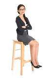 Asian female sitting on a chair Royalty Free Stock Photography