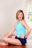 Asian female sitting indoors Royalty Free Stock Image