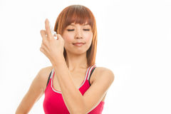 Asian female spraying hair Royalty Free Stock Photography