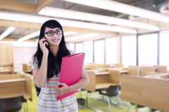 Asian female student calling in classroom Royalty Free Stock Photo