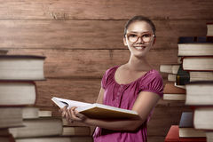 Asian female student carry a lot of books Stock Photography