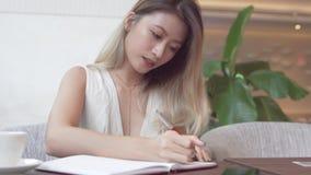 Asian female student learning english language royalty free stock photo
