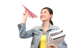 Asian female student  paper aeroplane - Series 3 Royalty Free Stock Photo