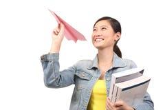 Asian female student  paper aeroplane - Series 3 Royalty Free Stock Photo