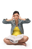 Asian female student stressed from studying Royalty Free Stock Image