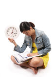 Asian female student studying on time for exams Royalty Free Stock Image