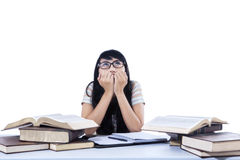 Asian female student worry - isolated. Asian female student is worry about exam on white background Royalty Free Stock Photo