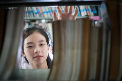Asian female students holding for selection Book  in library Stock Photo