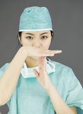 Asian female surgeon showing timeout signal Stock Photos