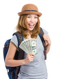Asian female traveler holding cash Royalty Free Stock Image