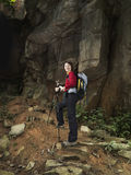 Asian Female Trekker prepares to scale a mountain Stock Photos