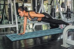 Female working out with push up in gym. Asian female working out with push up in gym royalty free stock photos