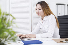 Asian female working on project Stock Image