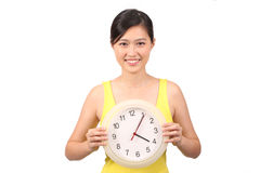 Asian female in yellow dress holding clock - Series 2 Royalty Free Stock Photography
