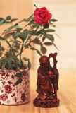 Asian figurine and Rosa stock image