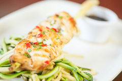 Asian fish dish with noodles and julienne vegetables Stock Image