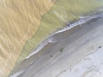 Aerial photo - fishermen are fishing by the beach using nets royalty free stock photo