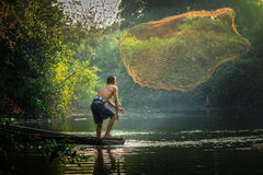 Asian fisherman fishing Royalty Free Stock Photography