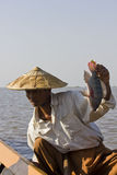 Asian Fisherman on Inle lake and his fish Royalty Free Stock Photography