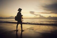 Asian fisherman on shore watching sunset Royalty Free Stock Photography