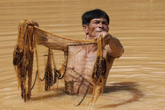 Asian fisherman with throw net. In the north part of Thailand royalty free stock photography