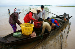 Asian fisherman, Tri An lake, river fish Stock Photography