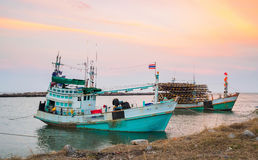 Free Asian Fishing Boats Dock Alongside The Shore Sunset Ba Royalty Free Stock Photography - 89493797