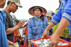 Asian fishing woman on the market Stock Images