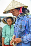 Asian fishing woman on the market Stock Photography