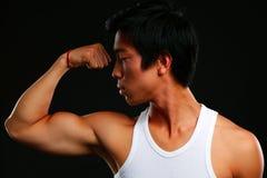 Asian fit man posing his muscles Stock Photos