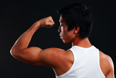 Asian fit man posing his muscles Stock Images