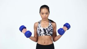 Asian Fitness Girl in Gray Camouflage Sport Bra black spandex pants, sunglasses Exercise stock footage