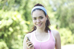 Asian fitness sport woman jogging smiling Stock Photos