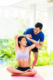 Asian fitness trainer exercising sport with woman Stock Image