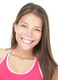 Asian fitness woman. Asian woman smiling portrait. Beautiful smiling mixed race caucasian / chinese young woman model in fitness tank top. Isolated on white Royalty Free Stock Photo