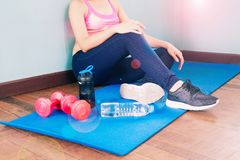 Asian fitness woman in sport clothing working out at home, Fitness and Healthy lifestyle royalty free stock photo