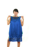 Asian fitting new dress Royalty Free Stock Photography