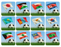 Asian flags and ball on grass. 3d. Soccer ball in the grass and the flag against the blue sky. Asian flags. 3d Royalty Free Stock Photography