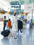 Asian flight attendant at International airport of Incheon. Incheon, South Korea - February 15, 2016: Asian Korean female flight attendant at International Stock Photos