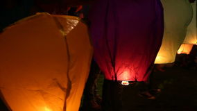 Asian floating lanterns into the night sky stock video footage
