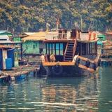 Asian floating village at Halong Bay Stock Image