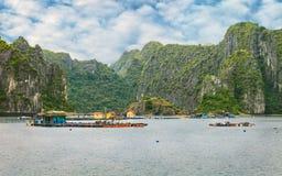 Asian floating village at Halong Bay Royalty Free Stock Photos